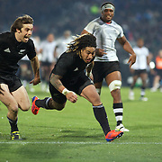 Conrad Smith (left) wins the race with team mate Ma'a Nonu to score a try during the New Zealand V Fiji Rugby Union test match at Carisbrook, Dunedin. New Zealand. 22nd July 2011. Photo Tim Clayton