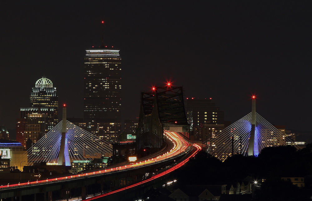 Boston night photography showing historic landmarks such as the Boston Prudential Center, Zakim Bridge and Tobin Bridge cityscape on a beautiful autumn night.<br />