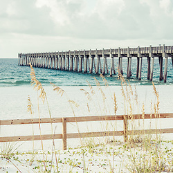 Pensacola Beach Gulf Pier and wooden fence panorama photo. Pensacola Beach is a coastal city along the Emerald Coast in the Southeastern United States. Copyright ⓒ 2018 Paul Velgos with All Rights Reserved.