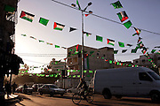 Flags of the militant group HAMAS hang across a busy street in Gaza City, Gaza December 19, 2009. The group, which seized complete control of the strip in 2007 has seemingly endured despite an international border blockade lead by Israel and Egypt, and appears to have retained popular support of the majority of Gaza Palestinians.