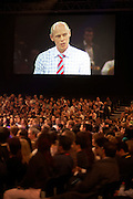 Accountancy employees watch their Chairman speaking at their corporate rally day, held for 3,000 UK staff at Excel