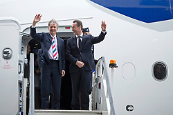 © London News Pictures.  04/07/2013 . London, UK.  Left to Right - Keith Williams, CEO of British Airways and Fabrice Bregier, President and CEO of Airbus  leave the British Airways  AIRBUS A380 superjumbo as it arrives at Heathrow Airport. It was the first time British Airlines have taken delivery of the new plane, making British Airways the first European airline to operate both the 787 and A380. Photo credit : Ben Cawthra/LNP
