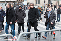 "© Licensed to London News Pictures. 10/01/2016. France, Paris. Charlie Hebdo Editor Laurent Sourisseau ""Riss"" leaves after the anniversary ceremony on Place de le Republique surrounded by his 24/7 police protection. Today January 10th 2016. Photo credit: Hugo Michiels/LNP"