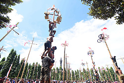 August 17, 2017 - Bali, Indonesia - Indonesians celebrate their 72nd independence day by doing greased pole climbing competition to win some prizes include motorcycle, in Renon Park, Bali, Indonesia, Thursday, August 17th 2017. (Credit Image: © Keyza Widiatmika/NurPhoto via ZUMA Press)