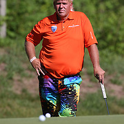 John Daly, USA, in action during the first round of the Travelers Championship at the TPC River Highlands, Cromwell, Connecticut, USA. 19th June 2014. Photo Tim Clayton