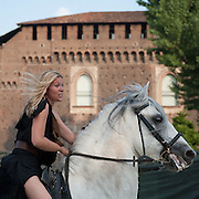 MILAN, ITALY - JUNE 05:  A woman wearing an amazon costume rides in front of Castello Sforzesco during the 1st Palio Citta' di Milano  on June 5, 2010 in Milan, Italy. The Palio Citta di Milano is a re-enactment of a medieval tournament in which only women partake as commemoration of the courage displayed by local women during the Vigevano siege of 1449.  (Photo by Marco Secchi/Getty Images)