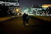 TOKYO, JAPAN, Chiyoda ku - A couple walk between Emperor Palace and Ginza. March 2010