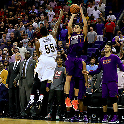 Nov 4, 2016; New Orleans, LA, USA; Phoenix Suns guard Devin Booker (1) shoots over New Orleans Pelicans guard E'Twaun Moore (55) as time expires in the fourth quarter sending the game to overtime at the Smoothie King Center. The Suns defeated the Pelicans 112-111 in overtime. Mandatory Credit: Derick E. Hingle-USA TODAY Sports