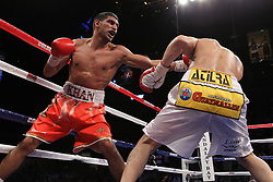 December 11, 2010; Las Vegas, NV; USA; Amir Khan (red) and Marcos Maidana (white) during their 12 round WBA 140lb championship bout at the Mandalay Bay Events Center in Las Vegas, NV.  Khan won via unanimous decision.  Photo: Ed Mulholland/HBO  (HBO Usage Only)