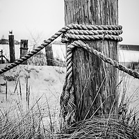 Photo of the New Buffalo Michigan wooden post and rope.
