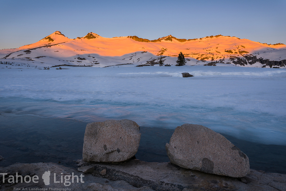 Desolation wilderness backcountry winter trip. Winter sunrise and Alpin-glow on Pyramid and Mt. Price peaks from the back of Aloha Lake