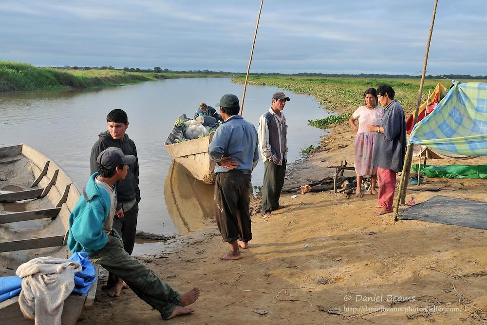 Chimani people on a river near San Lorenzo de Moxos, Beni, Bolivia