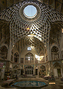 Stunning photographs reveal the beautiful ceilings in Iran's mosques, bazaars and public baths<br /> <br /> For the past few decades, restrictions on travel to Iran has meant the country has been largely shut off from the Western world, but as visa sanctions are lifted in the light of a landmark nuclear deal, the local tourism industry is hoping for a flurry of visitors.<br /> It's not hard to see why Iran is listed as one of the top travel destinations of 2016, with its rich culture and history. <br /> Among the standout aspects of the nation is its beautiful ancient architecture, with the cities and towns littered with ornate and eye-catching mosques, public baths and markets. <br /> And unlike many other countries - the roof is not an afterthought, with many ceilings built as the centrepiece to the building, with many of the tile designs showcasing a display of intricate geometric patterns that date back several centuries. <br /> French photographer Eric Lafforgue has travelled the country photographing the ceilings of indoor markets, mosques and bath houses. <br /> <br /> Photo shows: The dome of Timche Ye Amin Al Dowleh Caravanserai - an old bazaar in the center of the city of Kashan.