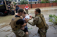 Volunteers and rescue workers get residents out of a flooded area of Houston along I-10 on the west side near Dairy Ashford road, in Houston, TX on Tuesday August 29, 2017. (Photo/Scott Dalton)