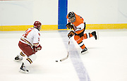 2010/03/26 - RIT forward Cameron Burt is defended by Denver's John Ryder. The RIT Men's Hockey team upset #2 overall seed Denver University 2-1 on Friday, March 26th, 2010 at the Times Union Center in Albany, N.Y.