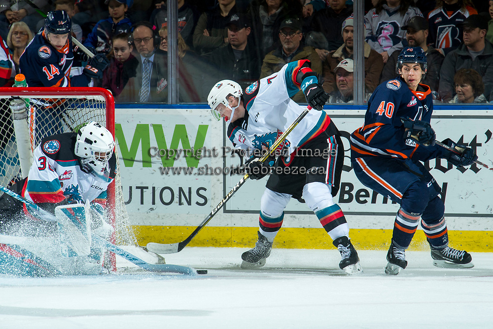 KELOWNA, BC - DECEMBER 27: Roman Basran #30 makes a save as Conner McDonald #7 of the Kelowna Rockets clears the puck from the crease during first period against the Kamloops Blazers  at Prospera Place on December 27, 2019 in Kelowna, Canada. (Photo by Marissa Baecker/Shoot the Breeze)
