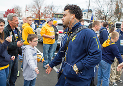 Nov 7, 2015; Morgantown, WV, USA; West Virginia Mountaineers running back Rushel Shell high fives fans as he arrives to the stadium to play the Texas Tech Red Raiders at Milan Puskar Stadium. Mandatory Credit: Ben Queen-USA TODAY Sports