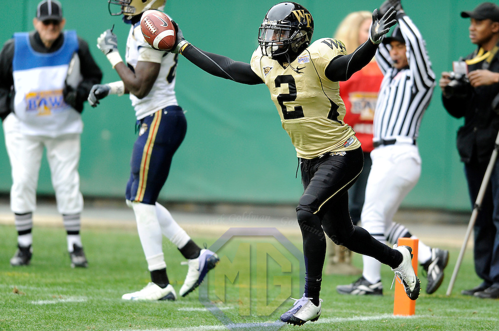 20 December 2008:   Wake Forest cornerback Alphonso Smith (2) celebrates after intercepting a pass on the 2-yard line thrown by Navy quarterback Kaipo-Noa Kaheaku-Enhada in the 2nd quarter.  The Wake Forest University Demon Deacons defeated the Naval Academy Midshipmen 29-19 in the inaugural EagleBank Bowl in Washington, D.C.