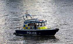 © Licensed to London News Pictures. 29/11/2019. London, UK. A Police boat on the Thames at Vauxhall Bridge as RNLI and Ambulance crews remove a body of an unidentified person from the beach on the north side of Vauxhall Bridge during this morning's rush hour where a body of an unidentified person was found. Photo credit: Alex Lentati/LNP