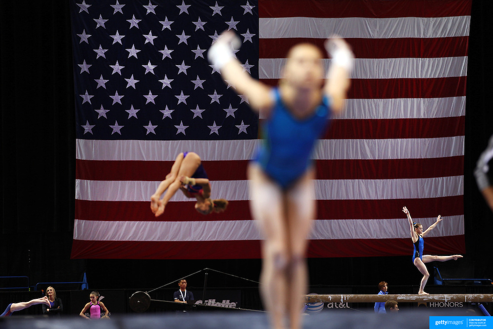 Gymnasts in action during a final training session before the start of The 2013 P&G Gymnastics Championships, USA Gymnastics'?? national championships which runs from Thursday until Sunday at the XL, Centre, Hartford, Connecticut.<br /> The event features gymnasts in both the junior and senior divisions. Performances will determine all-around and individual event national champions, as well as the national team for the junior and senior elite levels. Hartford, Connecticut, USA. 14th August 2013. Photo Tim Clayton
