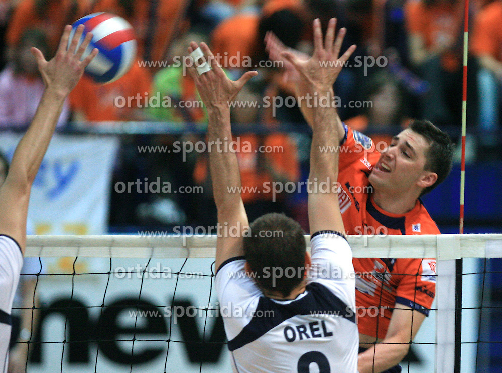 Igor Orel of Salonit vs Andrej Flajs of ACH  at last final volleyball match of 1.DOL Radenska Classic between OK ACH Volley and Salonit Anhovo, on April 21, 2009, in Arena SGS Radovljica, Slovenia. ACH Volley won the match 3:0 and became Slovenian Champion. (Photo by Vid Ponikvar / Sportida)