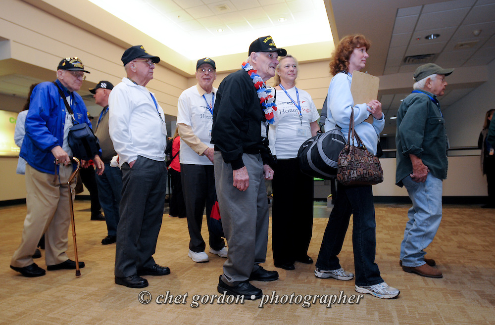 WWII Veterans and their escorts depart Stewart International Airport in Newburgh, NY during their Hudson Valley Honor Flight to Washington, DC on Saturday, April 26, 2014. One Hundred WWII Veterans from the Hudson Valley region of New York toured the WWII Memorial in Washington, DC and Arlington National Cemetery in Arlington, VA.  © www.chetgordon.com