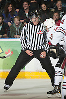 KELOWNA, CANADA - NOVEMBER 9:  Mike Langin, linesman prepares to drop the puck as the Red Deer Rebels visit the Kelowna Rockets on November 9, 2012 at Prospera Place in Kelowna, British Columbia, Canada (Photo by Marissa Baecker/Shoot the Breeze) *** Local Caption ***
