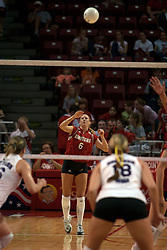 25 September 2004     Kelly Rikli serves.    Illinois State University Redbirds V University of Northern Iowa Panthers Volleyball.  Redbird Arena, Illinois State University, Normal IL
