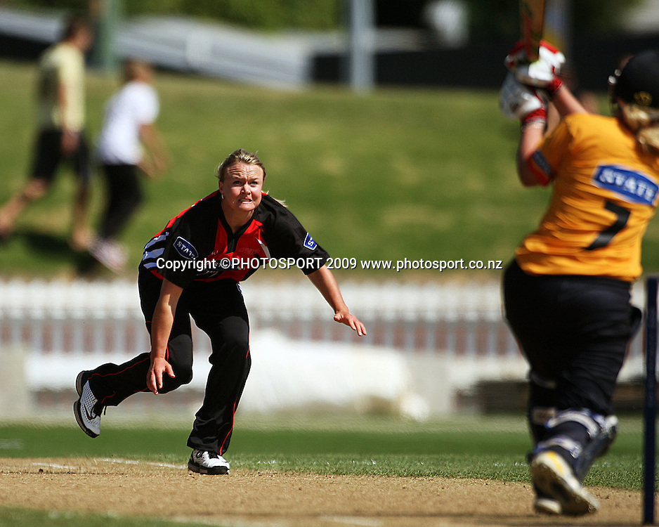 Wellington opener Lucy Doolan hits Beth McNeill's ball to the boundary.<br /> State League 20/20 final. Wellington Blaze v Canterbury Magicians at Allied Prime Basin Reserve, Wellington. Saturday, 25 January 2009. Photo: Dave Lintott/PHOTOSPORT