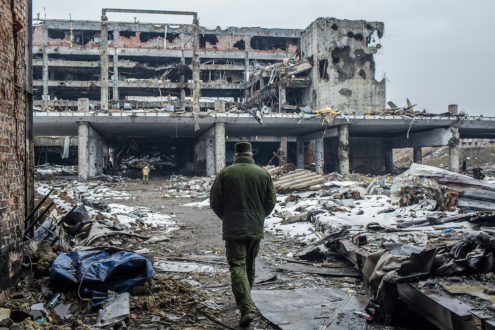 Eduard Basurin, center, the deputy defense minister of the Donetsk People's Republic, at the ruins of the Donetsk Airport on Tuesday, March 22, 2016 in Donetsk, Ukraine.