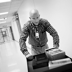 Kyle Green | The Roanoke Times<br /> 12/5/2011 The Rev. Dan Netting pushes a cart of bibles and spiritual material through the hallways of the Western Virginia Regional Jail. The ministry that pays for the chaplains in the three jails of the Roanoke Valley has had dwindling contributions and volunteers since its full-time chaplain retired in 2004. The Rev. Dan Netting, a Presbyterian pastor, splits time between the Roanoke County-Salem Jail and the Western Virginia Regional Jail. That&rsquo;s one man to counsel 800 people.