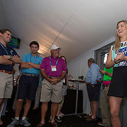 August 19, 2014, New Haven, CT:<br /> Eugenie Bouchard visits guests in suites on day five of the 2014 Connecticut Open at the Yale University Tennis Center in New Haven, Connecticut Tuesday, August 19, 2014.<br /> (Photo by Billie Weiss/Connecticut Open)