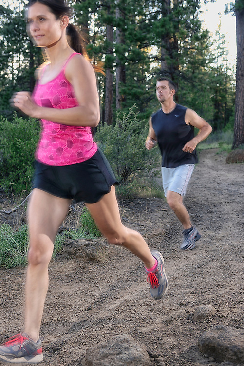 Couple running, near Dillon Falls,Deschutes River,Bend,Oregon,USA