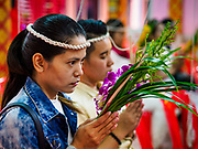 "14 FEBRUARY 2018 - BANG KRUAI, NONTHABURI, THAILAND: People pray during a resurrection ceremony at Wat Ta Khien, about 45 minutes from Bangkok in Nonthaburi province. The temple is famous for the ""floating market"" on the canal that runs past the temple and for the ""resurrection ceremonies"" conducted by monks at the temple. People lie in a coffin and ritualistically die before being reborn. Adherents believe it will improve their karma and help make up for past sins.         PHOTO BY JACK KURTZ"