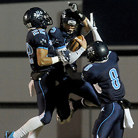 Hoggard's Harrison Smith, left, Austin Schoenleber, center, and Evan Allegret celebrate a touchdown against South Central High School in the first round of football playoffs Friday November 14, 2014. (Jason A. Frizzelle)
