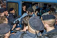 Roma, 12 Maggio  2014<br /> Manifestazione dei Movimenti per il diritto all'abitare hanno contestato il Presidente del Consiglio Matteo Renzi che parlava sul palco di piazza del Popolo per la manifestazione conclusiva del Partito Democratico in vista delle elezioni europee di domenica. Attivisti dei Movimenti per la Casa sono stati  fermati dalla Polizia. Nella foto, i manifestanti fermati dalla polizia vengono portati in commissariato<br /> Rome, May 12, 2014 <br /> Manifestation of the movements for housing rights, objected to the Chairman of the Board, Matteo Renzi, who spoke on stage at the Piazza del Popolo to the closing event of the Democratic Party in the European elections on Sunday. Activists of the Movement for the House were stopped by the police.In the picture  the protesters stopped by the police are brought to the police station