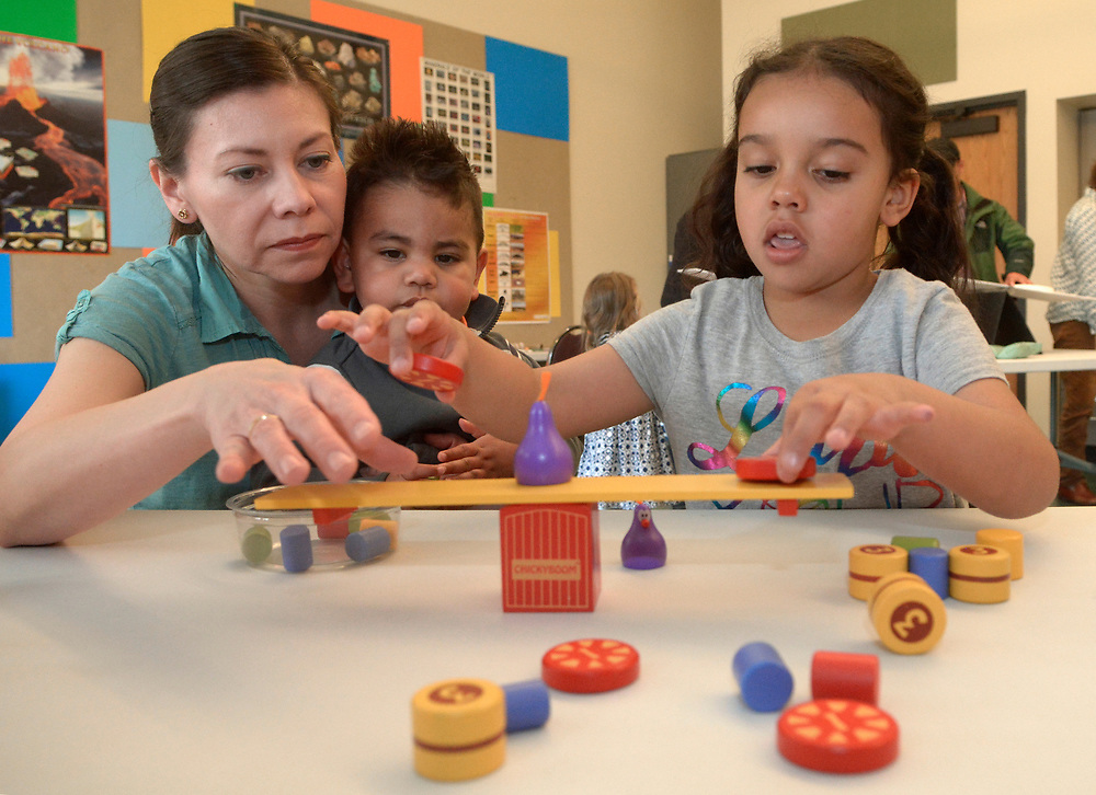 "gbs030517i/ASEC -- Elizabeth Espinosa of Bosque Farms with her son, Issac, 2, and niece, Olivia Otero, 4 , of Rio Ranchoexperiment with balancing weights during a Family Science Workshop at the New Mexico Museum of Natural History and Science on Sunday, March 5, 2017. The ""Balancing Act"" workshop lets kids and parents explore and manipulate the placement of weights and balancing their own bodies. The next Family Science Workshop ""The Force Is With You"" is on April 2, 2017.(Greg Sorber/Albuquerque Journal)"