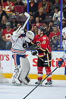 PENTICTON, CANADA - SEPTEMBER 17: Matthew Tkachuk #19 of Calgary Flames gets in the face of Dylan Wells #30 of Edmonton Oilers on September 17, 2016 at the South Okanagan Event Centre in Penticton, British Columbia, Canada.  (Photo by Marissa Baecker/Shoot the Breeze)  *** Local Caption *** Matthew Tkachuk; Dylan Wells;