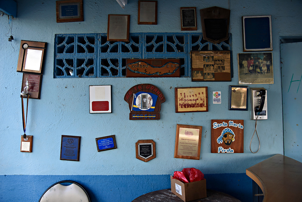 WILLEMSTAD, CURACAO - DECEMBER 11, 2014: The concession area of Frank Curiel Ball Park in Willemstad's Santa Maria area has a wall decorated with plaques, many honoring the man the park was named after. (photo by Melissa Lyttle)
