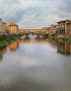 Ponte Vecchio is one of Florence's most famous images. Over the centuries, the bridge has survived floods and the havoc of war and strife. The present bridge was built in 1345. The name Ponte Vecchio means Old Bridge.<br /> <br /> Available sizes:<br /> 11&quot; x 14&quot; print<br /> See Pricing page for more information.