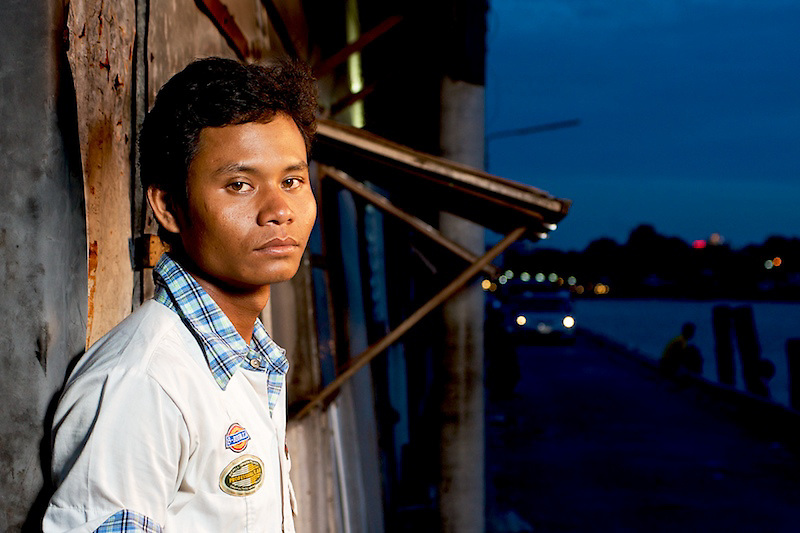 This picture show a young fisher man, waiting to be hired on a boat at the Fisherman's Pier in Pattaya Soi-12.