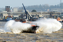 © Licensed to London News Pictures. 05/12/2013. Essex, UK. The south and east of England is preparing for severe storms and an extraordinarily high tidal surge tonight. A pilot's boat struggles upriver at Tilbury Port against strong westerly winds that have blown throughout the day. Photo credit : Simon Ford/LNP