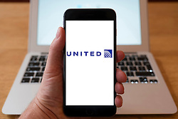 Using iPhone smartphone to display logo of United Airlines