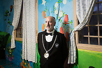 LECCE, ITALY - 10 NOVEMBER 2016: Roberto Giannone, a trained sommelier and volunteer to lecture to female inmates on the arts and crafts of wine tasting and serving, poses for a portrait in the classroom of the largest penitentiary in the southern Italian region of Apulia, holding 1,004 inmates in the outskirts of Lecce, Italy, on November 10th 2016.<br /> <br /> Here a group of ten high-security female inmates and aspiring sommeliers , some of which are married to mafia mobsters or have been convicted for criminal association (crimes carrying up to to decades of jail time), are taking a course of eight lessons to learn how to taste, choose and serve local wines.<br /> <br /> The classes are part of a wide-ranging educational program to teach inmates new professional skills, as well as help them develop a bond with the region they live in.<br /> <br /> Since the 1970s, Italian norms have been providing for reeducation and a personalized approach to detention. However, the lack of funds to rehabilitate inmates, alongside the chronic overcrowding of Italian prisons, have created a reality of thousands of incarcerated men and women with little to do all day long. Especially those with a serious criminal record, experts said, need dedicated therapy and professionals who can help them.