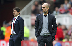 Manchester City manager Pep Guardiola (right) and Middlesbrough manager Aitor Karanka on the touchline