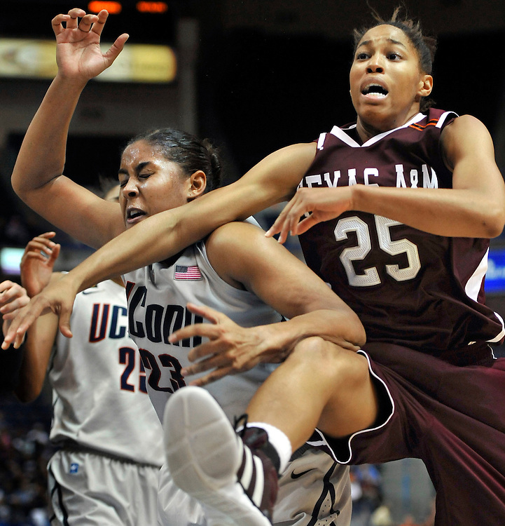 Connecticut's Kaleena Mosqueda-Lewis, left, collides with Texas A&M's Skylar Collins, when chasing a loose ball in the second half of an NCAA college basketball game in Hartford, Conn., Tuesday, Dec. 6, 2011.  Connecticut won 81-51.  (AP Photo/Jessica Hill)