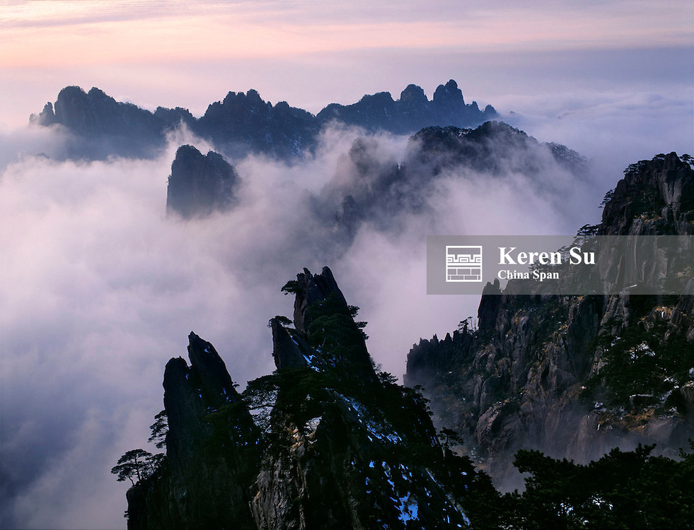 Mountain peaks in mist at sunrise, Mt. Huangshan (Yellow Mountain), Anhui Province, China