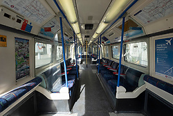 © Licensed to London News Pictures. 21/03/2020. London, UK. An empty train carriage. British Prime Minister Boris Johnson has ordered cafes, bars, restaurants and gyms to close in an attempt to mitigate the spread of coronavirus and COVID-19. Photo credit: Ray Tang/LNP