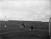 24/04/1960<br /> 04/24/1960<br /> 24 April 1960<br /> Soccer, F.A.I. Cup Final: Shelbourne v Cork Hibernians at Dalymount Park, Dublin. Charlie Tully(Cork Hibs.) (in air left) goes in hard.