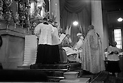 25/07/1962<br /> 07/25/1962<br /> 25 July 1962<br /> Consecration Rev. Dr Grimley S.M.A. as Bishop of Cape Palmas, Liberia at the Pro Cathedral, Dublin. Picture shows Very Rev. Nicholas Grimley S.M.A., kneeling on the steps of the altar at the feet of the Consecrating Prelate, Most Rev. Dr. McQuaid (seated) Archbishop of Dublin during the ceremony.